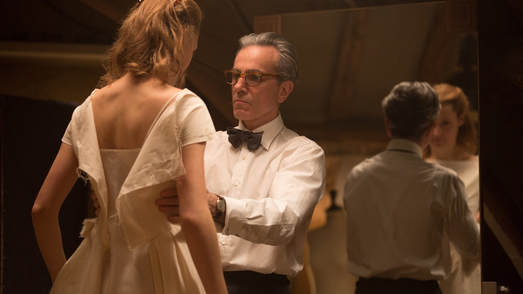 A screencap from Phantom Thread, by Paul Thomas Anderson. Daniel Day Lewis fits a dress onto his lover.