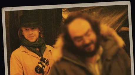 A picture of Leon Vitali, with Stanly Kubrick out of focus in the foreground.